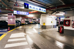 Underground parking in Bucharest. Underground car park in University Square, Bucharest, Romania with pedestrian crossings sign boards to toilets and information Stock Photography