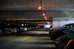 Underground parking with cars. Copy space Stock Photos