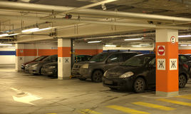 Underground parking with cars. Royalty Free Stock Image