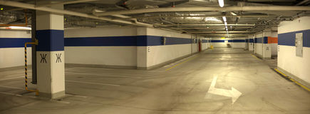 Underground parking with cars. Royalty Free Stock Photo