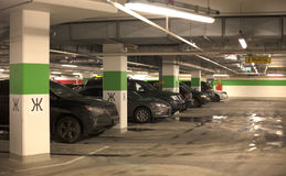 Underground parking with cars. Royalty Free Stock Photography