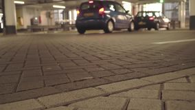 Underground parking with cars. Cars leave the parking lot stock footage