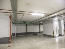 Underground parking for cars in a residential building royalty free stock photo