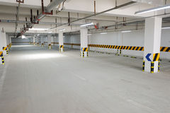 Underground parking garage. An empty underground parking garage royalty free stock image