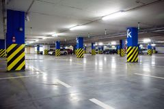 Underground parking garage with cars Royalty Free Stock Images