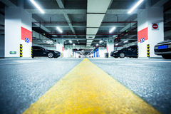 Underground parking garage Stock Images