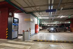 Underground parking or garage interior, auto with blurred motion effect, city car infrastructure Stock Photography
