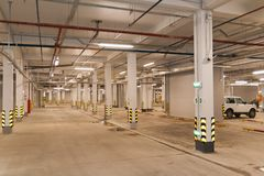 Underground parking. Parking garage, underground interior with a two parked cars Royalty Free Stock Photo
