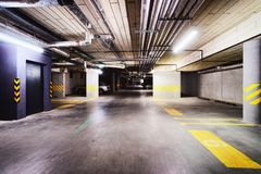 Underground Parking garage in modern apartment building stock photos