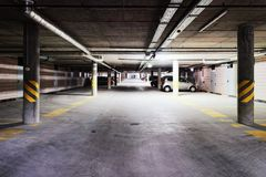 Underground Parking garage of modern building. Underground Parking garage of a modern building royalty free stock photography