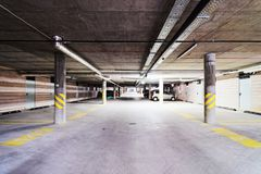 Underground Parking garage at modern building. Underground Parking garage at a modern building royalty free stock photos