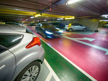 Underground parking. Garage with a moving car Stock Photos
