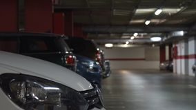 Underground parking, garage. shallow DOF. Underground parking, garage shallow DOF stock video footage