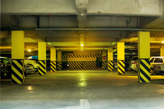 Underground parking garage shallow DOF color toned image. Underground parking with some cars in it Royalty Free Stock Image