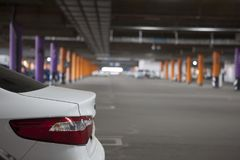 Underground parking is a large shopping center. There are not many cars. T. He image can be used as a background, there is room for text placement Royalty Free Stock Photo