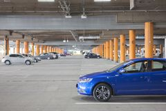 Underground parking is a large shopping center. There are not many cars. A modern highway, equipped in accordance with the concept of security Stock Images