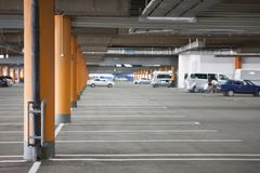 Underground parking is a large shopping center. There are not many cars. The image can be used as a background, there is room for text placement Royalty Free Stock Photography