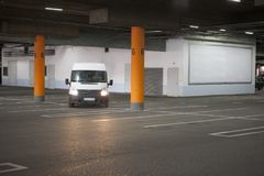 Underground parking is a large shopping center. There are not many cars. The image can be used as a background, there is room for text placement Stock Photos
