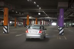 Underground parking is a large shopping center. There are not many cars. stock photos
