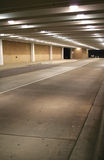 Underground parking lot. Road leading to parking lot Stock Photos