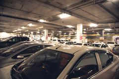 Underground parking. Parking lot of city shopping mall Royalty Free Stock Photography