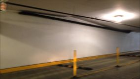 Underground parking. Making exit of underground parking for Thrifty Food shopping stock video footage
