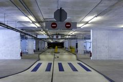 Underground parking with no cars. Empty underground parking in an office building Royalty Free Stock Photos