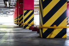 Underground parking of the Shopping Center. Parking garage underground, industrial interior, parking lanes
