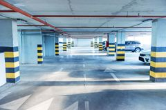 Underground parking. Garage with a lot of cars Stock Photo