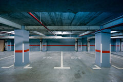 Underground parking view. This photograph represents an underground parking view in a modern residential building. Useful file for your new architecture project Stock Photography
