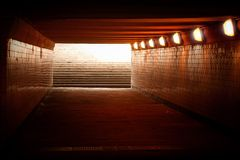 Underground passage. With lights and stairs in glowing end Stock Photo