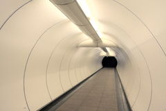 Underground passage. People passing busy road safely through it Stock Photos