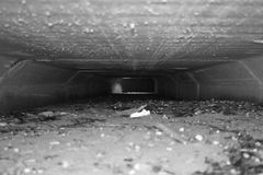Underground passage black and white. Derelict underground passage black and white colored detailed point of view Royalty Free Stock Photography