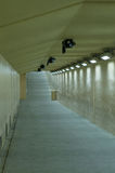 Underground passage. Illuminated underground passage in neutral colors royalty free stock images