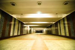 Underground passage with lights on without people at night.  Royalty Free Stock Photos