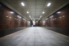 Underground passage with lights. On without people at nightr Stock Photo