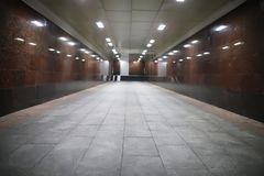 Underground passage with lights. On without people at nightr Royalty Free Stock Photography