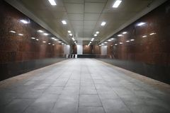 Underground passage with lights. On without people at nightr Stock Photos