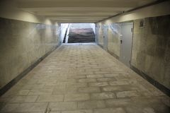 Long underground passage. The underground passage lined with gray granite and marble Royalty Free Stock Images