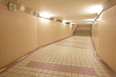 Underground passage at a metro railway station Royalty Free Stock Images