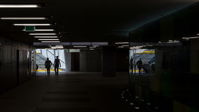 UNDERGROUND PASSAGE. Modern urban pedestrian-style architecture and passerby Stock Photography