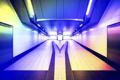Underground passage through the road, mirror two exits, select t. He road concept Royalty Free Stock Photography