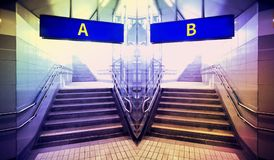 Underground passage with two stairs, select the road concept.  Royalty Free Stock Images