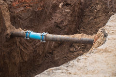 Underground pipe connector. Maintenance and repair gas and water pipe leak Stock Images