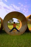 Underground Pipes & Boy Royalty Free Stock Photography
