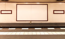 Underground platform with empty advertising boards Stock Photo