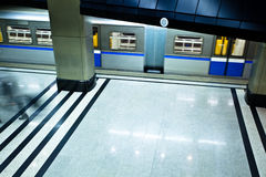 Underground platform interior with move train Royalty Free Stock Image