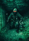 Underground post apoc beast. Underground post apocalyptic creature with homemade weapons and lantern royalty free stock images