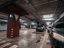 Underground public garage parking with cars. Movie style toned stock images