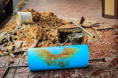 Underground PVC pipe of the water supply is broken and being rep Royalty Free Stock Photography